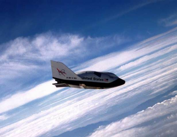 The X-38, a research vehicle built to help develop technology for an emergency Crew Return Vehicle (CRV), descends under its steerable parachute during a July 1999 test flight at the Dryden Flight Research Center, Edwards, California. It was the fourth free flight of the test vehicles in the X-38 program, and the second free flight test of Vehicle 132 or Ship 2.  (S. Rankin Creative Commons photo)