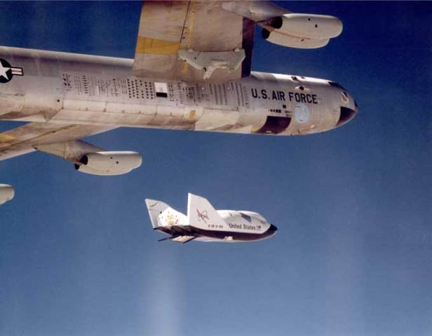 "The X-38 research vehicle drops away from NASA's B-52 mothership immediately after being released from the B-52's wing pylon. More than 30 years earlier, this same B-52 launched the original lifting-body vehicles flight tested by NASA and the Air Force at what is now called the Dryden Flight Research Center and the Air Force Flight Test Center. NASA B-52 Tail Number 008 is an air launch carrier aircraft ""mothership,"" as well as a research aircraft platform that has been used on a variety of research projects. NASA Public Domain photo"