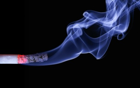 cigarette with smoke rising from it