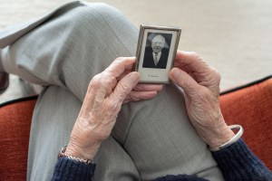 Man holding a photo