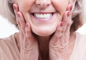 close up of senior woman's white teeth