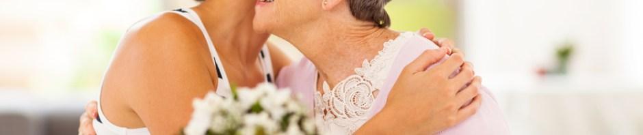woman hugging her elderly mother