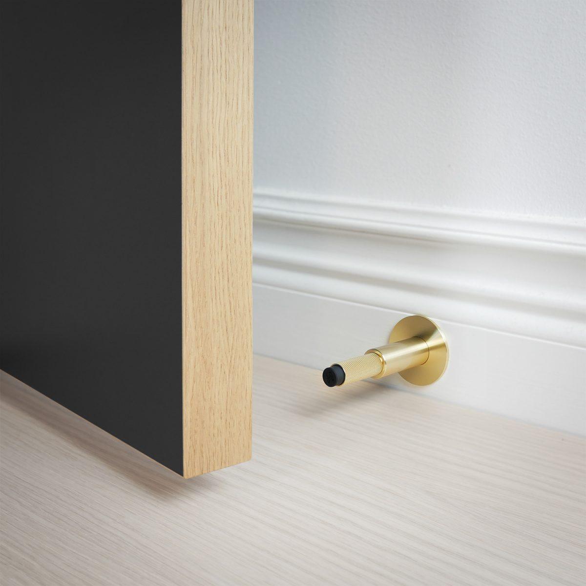dörrstopp-vägg-dörr-mässing-buster-punch-njord