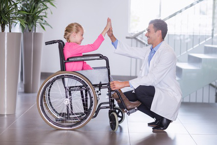 Doctor and his patient in wheelchair