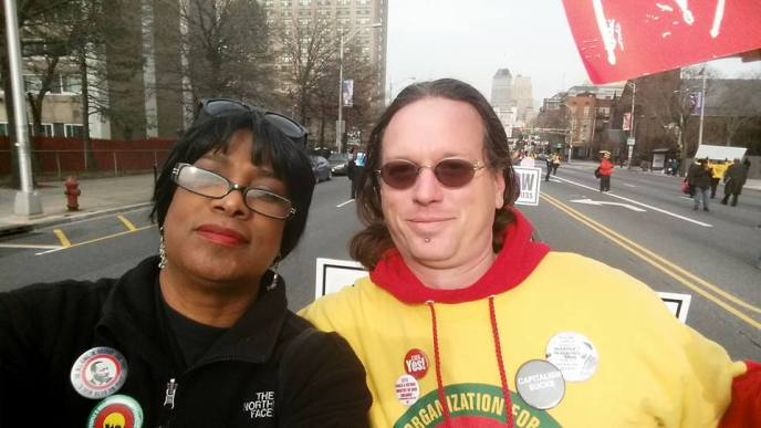 Darlene Troutman and Brian Powers marching for social justice in Newark NJ