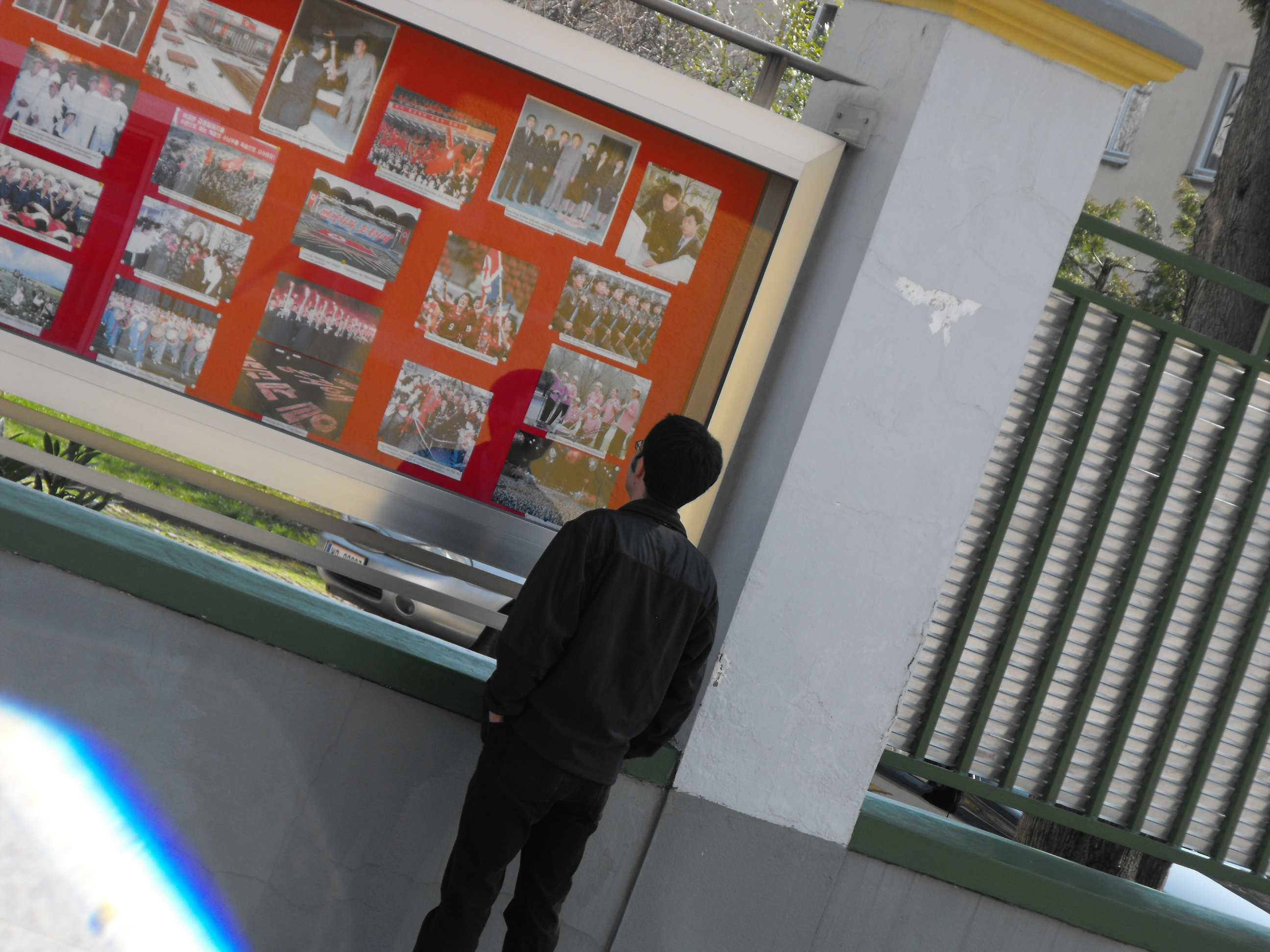 Your servant humble looking at the photo display outside the DPRK Embassy in Vienna