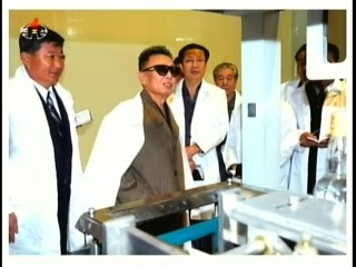 A Taedonggang Food stuffs Factory Manager, Kim Jong-il, Jang Song-thaek and a partially obscured official of the Personal Secretariat (Photo: Korea Central TV)