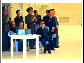 Kim Jong-il and his entourage enjoy the competitive divers at Kim Il-sung University. (Photo: Korea Central TV)