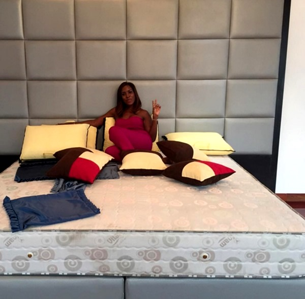 Linda Ikeji on her bed