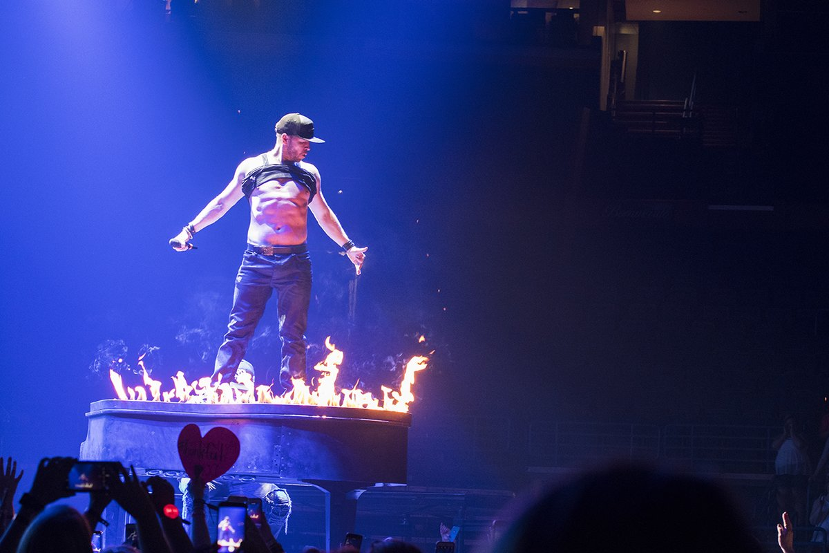Donnie Wahlberg on a piano on fire