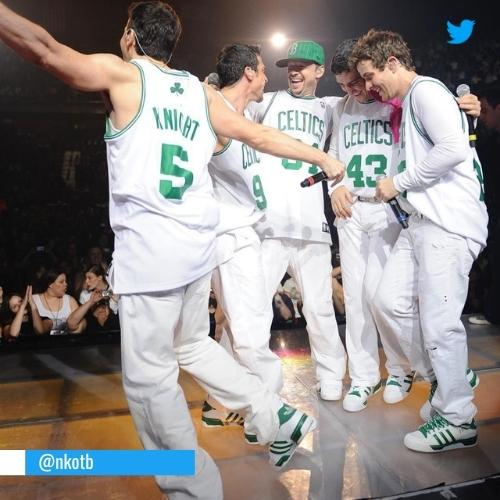 New Kids On The Block on stage wearing Celtics t-shirts