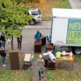 Volunteers delivering furniture to house