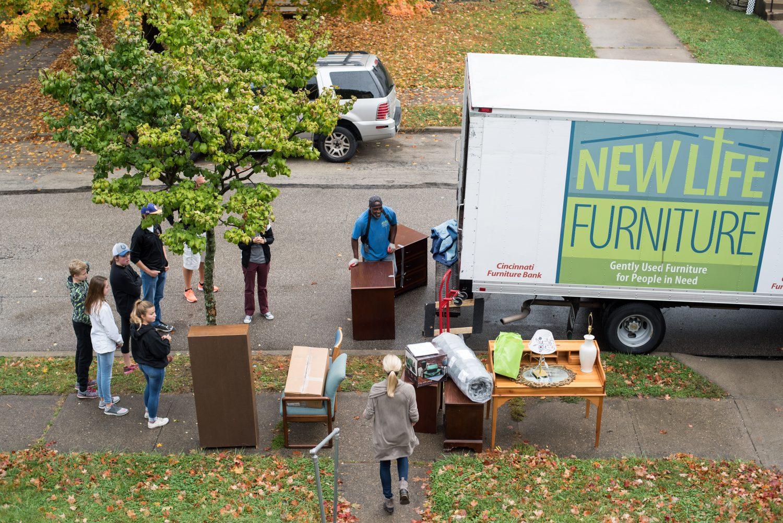 Volunteers delivering furniture to house
