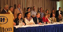 Delegation members holding a press conference to offer their impressions of democracy in Venezuela