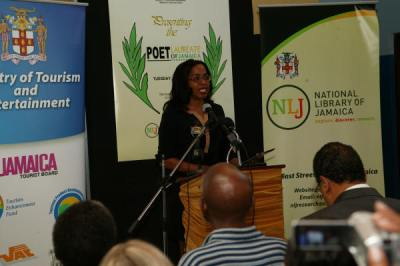 Vice Chair of the Board of Management of the National Library of Jamaica, Kellie Magnus, brings greetings on behalf of the National Library.