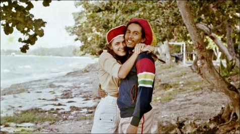 Cindy Breakspeare and Bob Marley on a beach