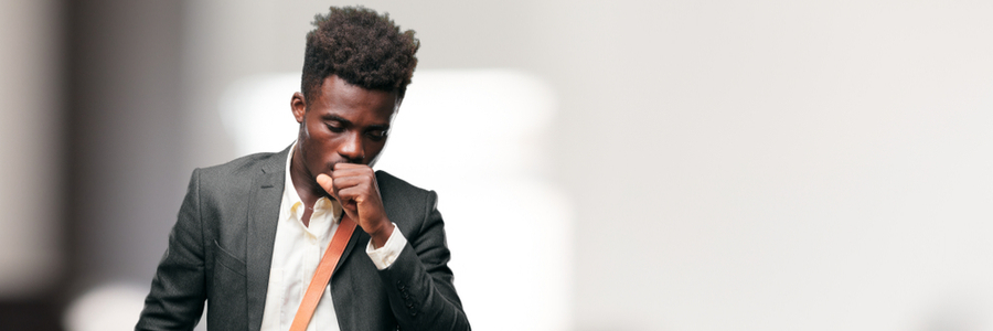 young black businessman coughs