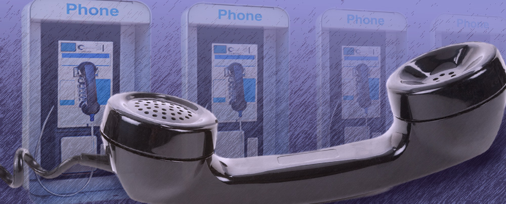 Large phone in the foreground in front of four pay phones that gradually fade into the background