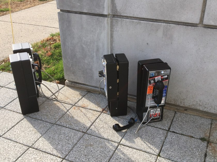 Payphones sit outside of the National Library of Medicine, having been removed from use in the building.