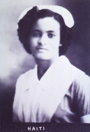 A black woman in a Nurse's uniform.