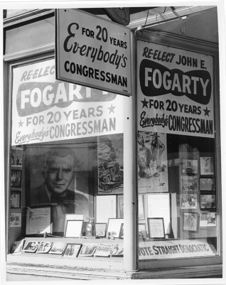Posters and photographs in a storefront window advertise Fogarty's campaign.