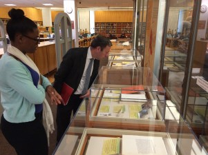 People look in display cases in the Library.