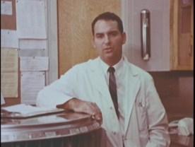 Doctor in white coat.