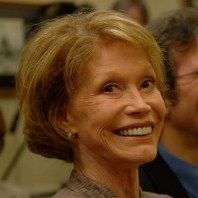 Close-up of Mary Tyler Moore smiling broadly