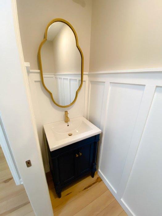 Vanity and mirror in the half bathroom