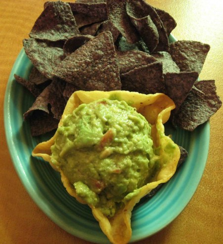 Guacamole and blue corn tortilla chips
