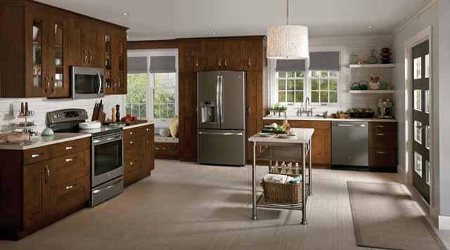 Matte Kitchen Appliances Brown and Tan Kitchen with Metal Island and Silver Appliances