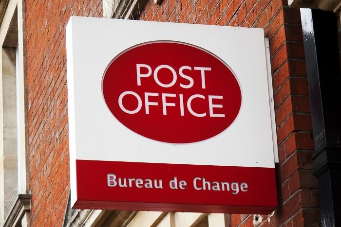 Exchange foreign currency at the post office