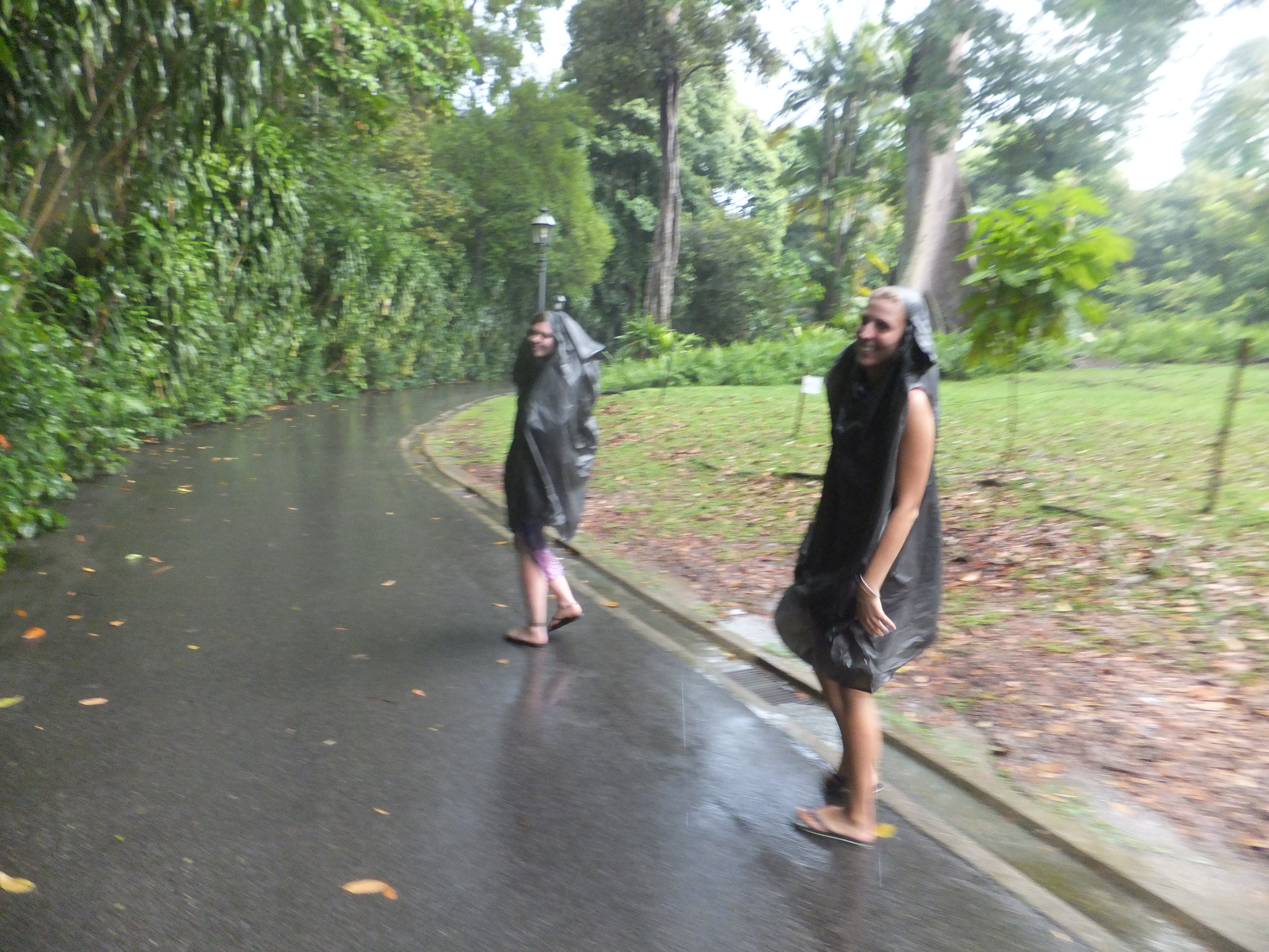 Girls running through the rain