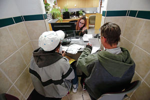 Karume Henry, left, from Santa Fe, and Christina E. Nelson, right, from Santa Fe, speak with Linda Montero, a family assistance analyst at the Human Services Department, while they apply for food stamps on Wednesday, March 8, 2016. Luis Sánchez Saturno/The New Mexican