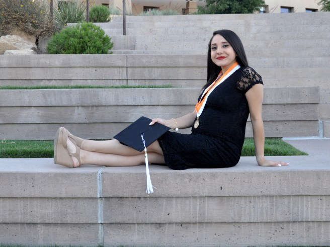 Margarita Ibarra at Utep's Centtenial park posing for graduation pictures, Sunday, April 30, 2017.
