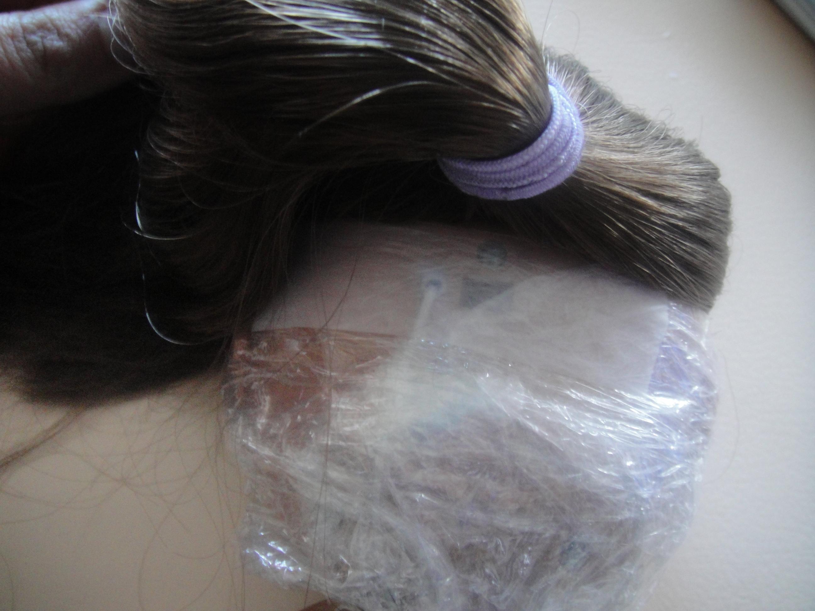 Asha's covered head back