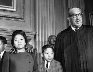 Cecilia Marshall (2nd from left) and Justice Thurgood Marshall (right) in an undated photo. (TMC)
