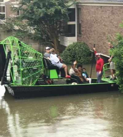 Family of Sonny Messiah-Jiles, Publisher of The Houston Defender, rescued by boat from their home as a result of rising flood waters in Houston. Photo: Clyde Jiles