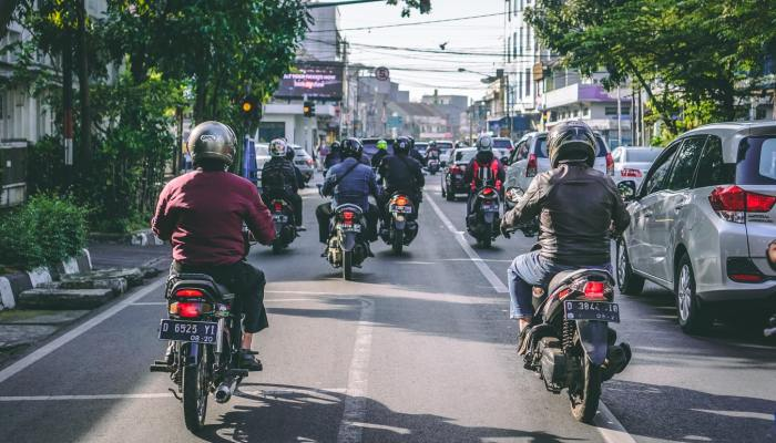 motorcyclists on a street in Thailand