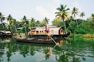 man paddling in boat on river