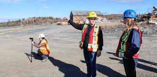 Natalie Plato, deputy director of the Giant Mine Remediation Project, centre, leads media on a tour of Giant Mine site. Sidney Cohen/NNSL photo.