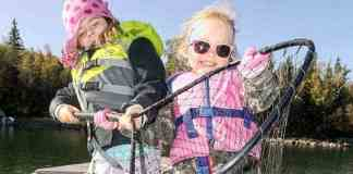Alexie Bryant, the Duchess of Squishy Pets, and Arizona of Gregory, winner 2018 annual Yellowknifer Catch of Week contest, shows off their mighty catch of sparkly whitefish while on a journey to Prosperous Lake earlier this month. The whitefish was caught using a magic, pink wire jewel bug. Mike W. Bryant/NNSL photo.