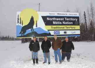 The presidents of the Northwest Territory Metis Nation and its community councils gathered on Nov. 22 to officially introduce a new sign at the junction of Highway 5 and Highway 2 welcoming travellers to their traditional territory. The leaders are, left to right, Arthur Beck of the Fort Resolution Metis Council, Garry Bailey of the Northwest Territory Metis Nation, Ken Hudson of the Fort Smith Metis Council and Trevor Beck of the Hay River Metis Government Council. Paul Bickford/NNSL photo