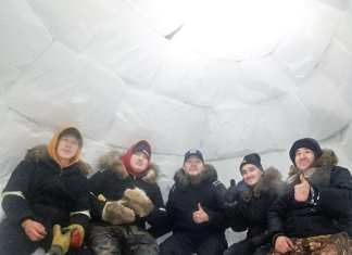 Jimmy Ishalook, from left, Andrew Kuksuk, Jackson Kablutsiak, Nap karetak and Robert Karetak are all smiles inside the iglu they built in Arviat on Feb. 12, 2019. Photo courtesy Robert Karetak