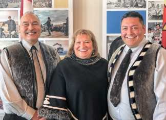 Nunavut Premier Joe Savikataaq, left, and Kivalliq Inuit Association (KIA) president David Ningeongan gladly accept the good news from Parliamentary Secretary to the Minister of Intergovernmental Affairs, Northern Affairs and Internal Trade Yvonne Jones that the KIA was receiving a $1.6 million grant from the Strategic Investments in Northern Economic Development (SINED) program of the Canadian Northern Economic Development Agency (CanNor) to help fund a feasibility study into the Kivalliq Hydro-Fibre Link Project. Photo courtesy KIA