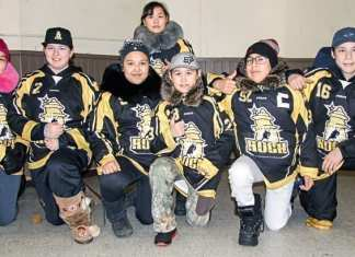 Rankin Rock peewee players, from left, Erin Kubluitok, Jaidyn Verbeek, Sophia Kaludjak, Kaylen-Janne Nakoolak (back), Kylan Saviakjuk,, Kadin Eetuk and Simon Wiseman appreciate the $5,000 donation they received from the Northern Pharmacy in Rankin Inlet on March 7, 2019. Darrell Greer/NNSL photo