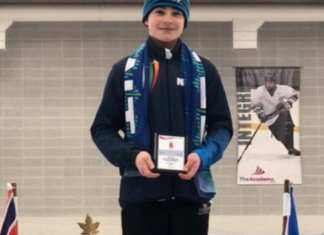 Sage Acorn stands atop the podium with his championship plaque after he won the overall title in the T2T 12 boys division at the Canada West Short Track Championships in Grande Prairie, Alta., on Sunday. photo courtesy of Kerry Egan