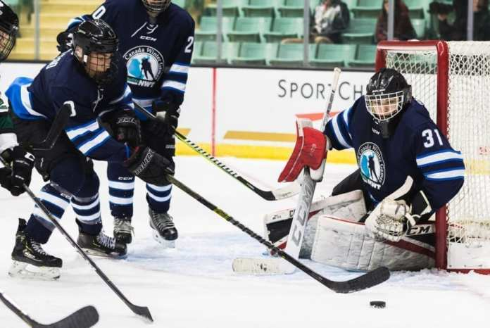 Carter McLeod reaches for the puck in front of goaltender Liam Tereposky during action at the Canada Winter Games in Red Deer, Alta., this past February. McLeod returned to Red Deer to play in the Alberta Cup bantam hockey tournament last week. Brandon White/Canada Winter Games photo