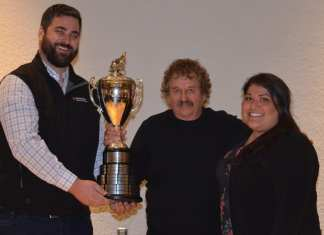 Richard Beck, centre, accepts the Canadian Championship Dog Derby winner's trophy from Nick Ballantyne, left, and Rebecca Plotner of Dominion Diamond Corporation during the awards dinner at the Explorer Hotel on Sunday. James McCarthy/NNSL photo
