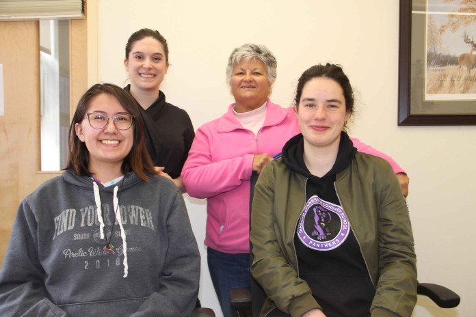 Kleo Skavinski, front left, and Elli Cunningham, front right, are among 13 students at Diamond Jenness Secondary School participating in this year's Duke of Edinburgh's International Award. The program is being promoted by Yellowknife's Sophie Kirby, back left, the award's program officer for the NWT and Nunavut, and Kim King, the career advisor at Diamond Jenness. Paul Bickford/NNSL photo